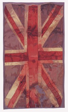 """VW Flag by Vivienne Westwood - The Rug CompanyThe iconic 'VW Flag' motif was first provocatively modeled as a bridal stole in the Autumn/WInter 02/03 'Anglophilia' collection. The raggedy worn-out and possibly blood-soaked original flag is precisely reproduced in very fine hand woven wool tapestry, which can used on the floor or as a hanging.  VW Flag comes in this original size of 8' x 4'9"""" (2.44 x 1.44m)"""