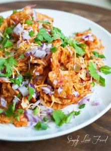 Chilaquiles: tortilla chips, red chile sauce OR salsa verde (green sauce), cotija cheese OR queso fresco, sour cream, cilantro, red onion, avocado.