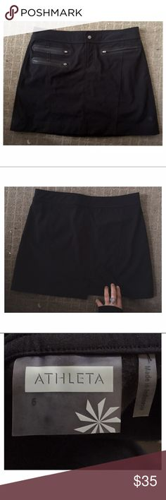 ATHLETA black zipper skirt: Sz. 6 / S/M Adjustable Never worn !! NWOT ATHLETA skirt with button closure and adjustable wasteline. Functional and flattering- not too short not too long with sweat resistant material. Offers welcome Skirts Mini