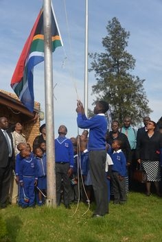 Megoring Primary School learner hoisting the national flag in Limpopo province National Flag, Primary School, South Africa, Outdoor Decor, Upper Elementary, Elementary Schools