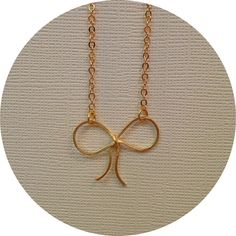 Gold Ribbon Bow Necklace by elladolce on Etsy