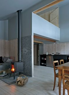 A wood-burning stove in the main room heats much of the house, including the mezzanine and the dining area.