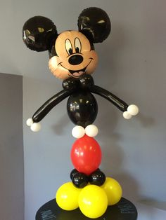 Mickey or Minnie Mouse balloon tower. Air filled. DIY kit with balloons, instructions and how to video link. 4-4.5 feet tall. Intermediate level.