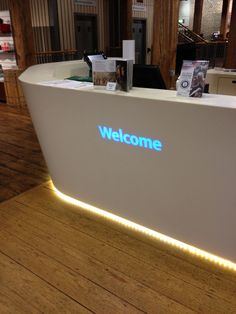 Translucent coloured 'Welcome' branding on a Mono Desk by isomi