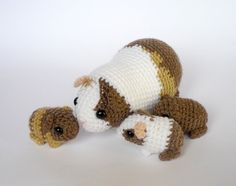 Crochet version of a guinea pig family, I love how the babies are all different variations on mom's colors - you never know what you are going to get in a piggy litter, but this lot really looks li...