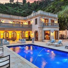 Perched on a prime Bel-Air lot of nearly 4 acres, with almost a full acre flat, this 19,000 sq ft 3 level estate boasts luxurious living and breathtaking mountain views throughout! | Listed at $22,500,000 by @The Agency RE | #BelAir #LosAngeles