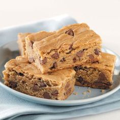 Peanut Butter Cake Bars Recipe -These cake-like bars are packed with peanut butter and chocolate chips, and they are perfect for any occasion. Kids and adults alike are in for a treat with these gems. —Charlotte Ennis, Lake Arthur, New Mexico