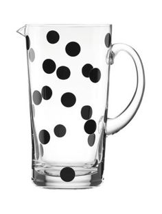 this glass pitcher, decorated with a smattering of black polka dots, is a stylish vessel for ice water, sangria or fresh-squeezed lemonade.