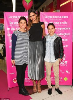 Shining star: Indigenous model Samantha Harris posed with fans at a Priceline in Sydney on Thursday as part of an in-store promotion to help raise funds for the Sisterhood Foundation