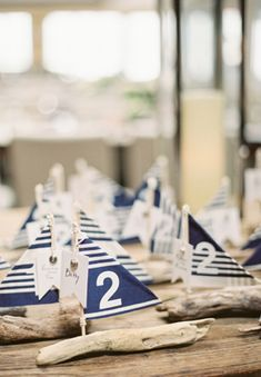 "nautical wedding escort boats - but you could do something like this for dinner parties or even make photo frames like this - pictures as the ""sail"""