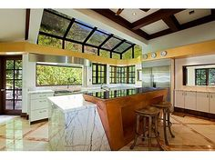 Marble counter tops magnify natural lighting for a sunny cook's paradise. #kitchen #window