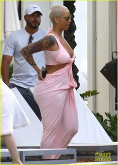 2fb3c2544a4e0 Amber Rose Says Family Skipped Her Wedding to Wiz Khalifa Because He s  African-American  Photo Amber Rose wears a low-cut pink dress while  relaxing poolside ...