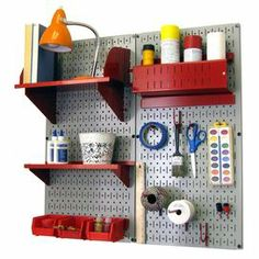 "Featuring 2 metal pegboards with an array of storage compartments and hooks, this organizer kit is perfect for stowing tools in the garage or sports equipment in the shed.   Product: 2 Pegboards 3 Shelves 10 HooksConstruction Material: Metal and steelColor: Gray and redFeatures:  Made in the USAMounting hardware includedDimensions: 32"" H x 16"" W each (pegboards)"
