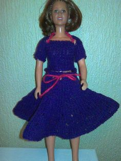 Hand knitted doll's clothes made from my own design