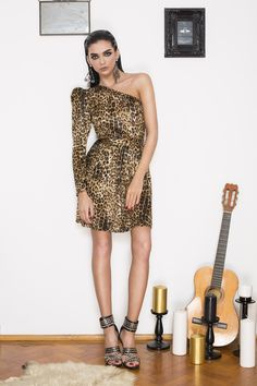 Tap into this season's wildest trend in our '80s inspired Nancy dress. Cut in soft-touch leopard print velvet, featuring a provocative one shoulder neckline, this dress has a voice of its own that says wild & wicked. The dramatic '80s silhouette, the never-goes-out-of-style pattern, and a fierce attitude combine for an extravagant look that's just right for evenings out. Disco Ball, Out Of Style, Pattern Fashion, Going Out, Attitude, Wicked, Party Dress, Stylists, One Shoulder