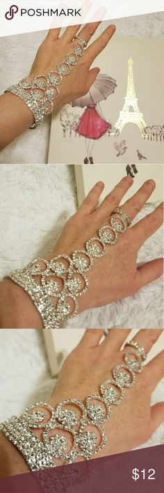 Crystal Bridal Ring Bracelet Stretchy Size Small Exquisite sparkling ring bracelet my friend bought for her wedding at the Bridal Boutique.  It's high quality piece, it's being held together by the elastic bands, so it has some stretch to it, but still is made for the smaller hand. Goes really well as an accent with an occasion gown or a prom dress.  All the stones are in place,  the bracelet has been worn just once for the wedding. Bridal Boutique Jewelry Bracelets