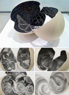 Graphite on broken egg sculptures by Scott Campbell