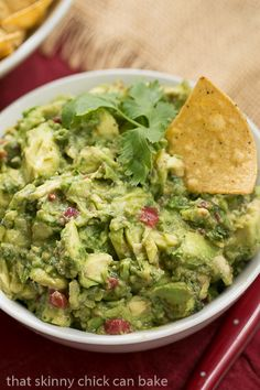 The BEST recipe for classic guacamole with avocados, jalapenos, tomatoes and cilantro