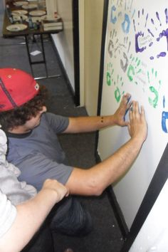 Youth Group Idea: Graduating seniors leave hand prints on wall in school colors, along with their name, class year, and maybe a bible verse.  This was one piece of a much larger Senior Night Fest that was emotional but fun, and quickly became something the rising seniors looked forward to every year.