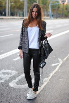 leather jeans, white converse, black and white cardigan, black leather bag