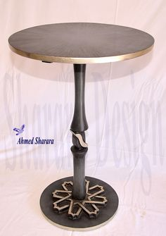 Wooden table with special finishing by Sharara Design