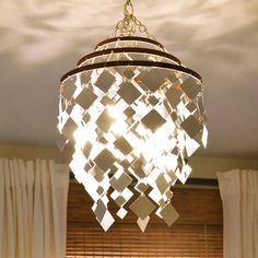 Use mirrors to craft this stunning sparkling light infused DIY chandelier for your bedroom for a fresh updated look! Plus 20 more DIY Bedroom Makeover Ideas to give your bedroom a fresh and inviting new look without spending a lot of money. Old Chandelier, Sparkling Lights, Drum Shade Chandelier, How To Make A Chandelier, Plastic Lights, Jar Chandelier, Mason Jar Chandelier, Chandelier, Diy Chandelier