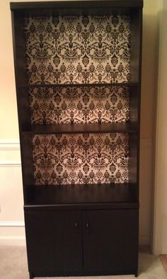 Refurbished furniture! Bought this old bookcase at goodwill for 10, repainted it black and added black and white damask wallpaper to the backing! YAY!