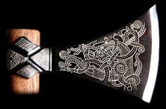 Viking axe head with blackened blade and engraved design of a dragon. Copied from an axe found in a Viking grave at Mammen, Denmark.