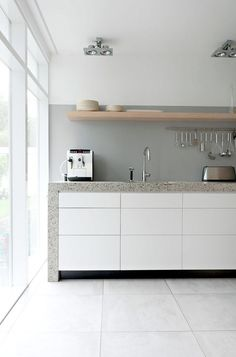 Exterior and Interior House in Beautiful Atmosphere: Minimalist Kitchen Space In Rietveld Bungalow With White Drawers White Cabinets Grey Co. Grey Cabinets, White Kitchen Cabinets, Painted Cupboards, White Counters, Painted Walls, Grey Kitchens, Cool Kitchens, Kitchen Interior, New Kitchen