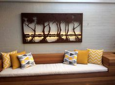 'Pandanus' laser cut wall art features within a contemporary outdoor setting. Image courtesy of Chris McGregor