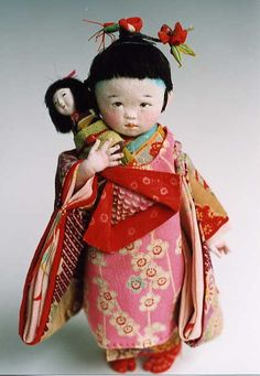 ilovejapan1080:  Mieko Minazumi   A cute kimono-clad toddler doll holding an anesama ningyou with a cloth body and wooden head.