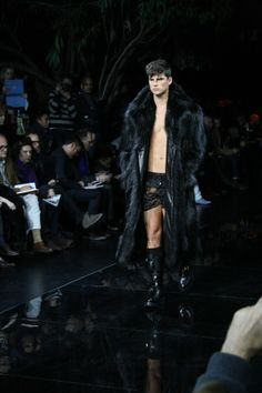 Versace runaway show: Male model wearing a long black fur coat . - Develop the sexual presence of a model! Click the pic.