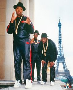 Run DMC in their famous leather tracksuits pictured in Paris. They're sporting Addidas and gold chains to show their wealth. http://www.dailymail.co.uk/tvshowbiz/article-2294873/David-Arquette-shows-nostalgia-Run-DMC-leather-tracksuit-heads-nightclub.html