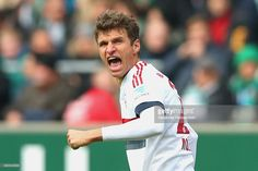 Thomas Mueller of Muenchen celebrates scoring the opening goal during the Bundesliga match between SV Werder Bremen and FC Bayern Muenchen at Weserstadion on October 17, 2015 in Bremen, Germany.