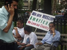 """Sign: """"We are Muslim Americans. We love our country."""""""