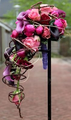 purple and pink weddingbouqet - love the use of vines to encage the bouquet