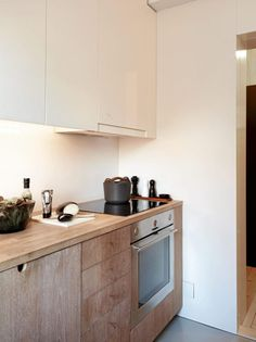 raw wood kitchen cabinets