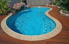 Kidney shaped above ground swimming pools with wooden decks