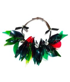 Necklace $49.95  DESCRIPTION  Marni. Short necklace with rhinestones and large plastic leaves. Adjustable leather cord at back.  DETAILS  100% polyacrylic. -  Imported.  MARNI at H&M
