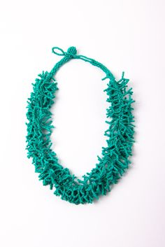 Beaded Coral Necklace - the texture and detail in this piece are beautiful. I saw these in Hawaii too!
