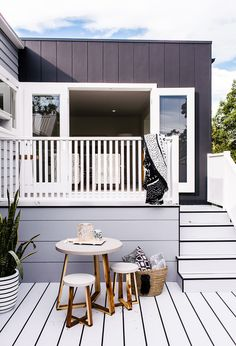This is the kind of space you could spend a lazy Sunday brunch in. Three Birds Renovations have used Scyon Axon (black) and Stria (grey) to create a fresh, elegant look. Small Space Living, Small Spaces, Three Birds Renovations, Grey Houses, Australian Architecture, Exterior Cladding, Hamptons House, Facade House, House Exteriors