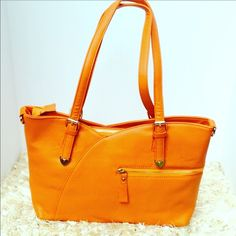 NEW Beautiful Orange Leather Handbag Beautiful color and perfect size to carry all your much needed items. Width is 14 inches height 10 inches and the base is 5 inches. Has plenty of pockets and compartments for storage. Does come with shoulder strap as pictured. Two available in orange color. Bags Shoulder Bags