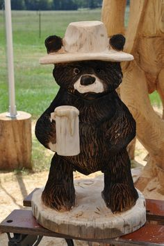 Beneath the Bark Chainsaw Carvings ... HaHa cool lil' bear drinking a frosty Beer :-) gotta have something like this for the MAN 'bear' CAVE on the BAR or ?
