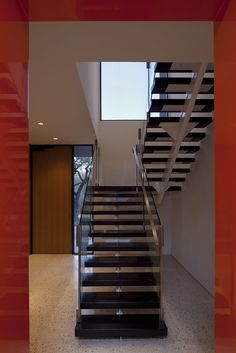 Open wood stair treads. Glass railing. Steel structure.
