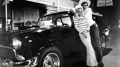 "Harrison Ford (""Bob Falfa"") with Chevy Coupe. ""American Graffiti"" Directed by George Lucas. Behind the scenes photos. 1955 Chevy, 1955 Chevrolet, Harrison Ford American Graffiti, Epic Film, Hot Cars, Custom Cars, Custom Trucks, Classic Cars, Classic Movies"