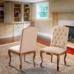 @Overstock - With its unique weathered frame and plush seat and back, you will want to keep a pair of these chairs in each and every room.http://www.overstock.com/Home-Garden/Weathered-Hardwood-Studded-Dining-Chairs-Set-of-2/6315762/product.html?CID=214117 $328.99