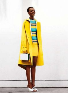 Sunny yellow coat //  Miguel Reveriego for Glamour Magazine