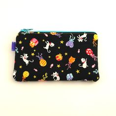 Party Kitties Change Purse:These little bags are the perfect accessory to keep you organized! They measure 6 inches by 4 inches and can be used as camera bags, change purses, wallets, makeup bags, really anything AND they make great gifts too. All Wolf Bait brand bags are interfaced to retain shape, padded for comfort and soft enough to fold. No visible raw edges... $10.00