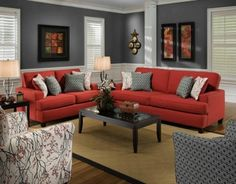 This room has an accent color scheme because it is mostly neutral colors with a pop of red in the couch.