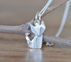 Silver fox necklace — These handmadeorigami-inspired accessories are...